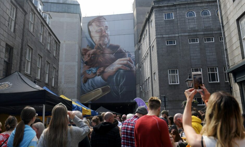 Hundreds joined walking tours of the Nuart street art around Aberdeen in 2019. Months before the pandemic, the Green was packed with visitors.