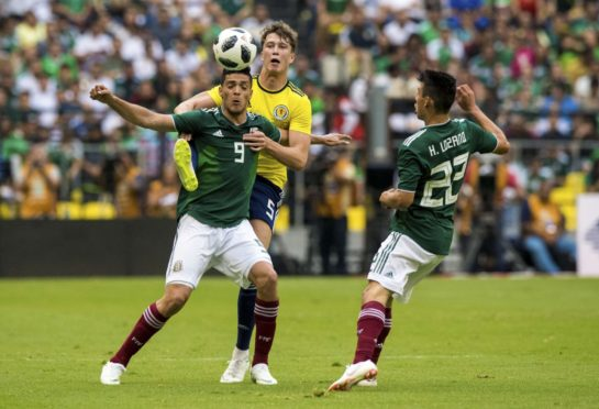 Jack Hendry in action for Scotland against Mexico.