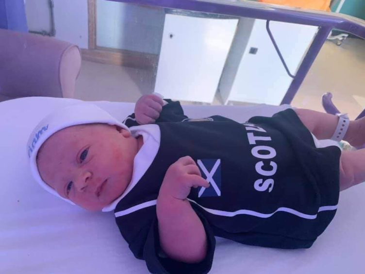 Liam kitted out in national colours just hours after he was born.