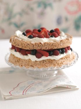 Macaroon cake with mixed berries.