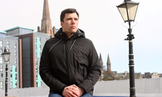 """Councillor Ryan Houghton in Rosemount Viaduct, near the Union Terrace Gardens construction site where granite was taken from and left at an """"unauthorised location""""."""
