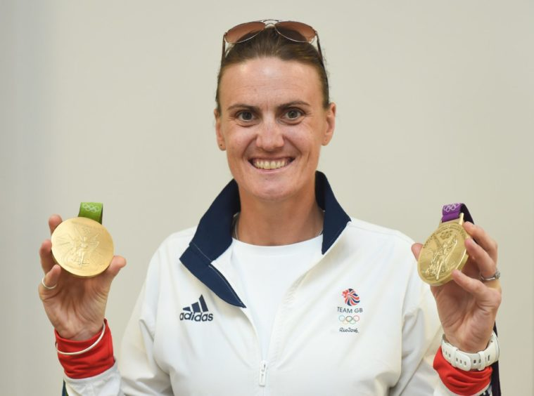 Heather Standing holds two gold medals.