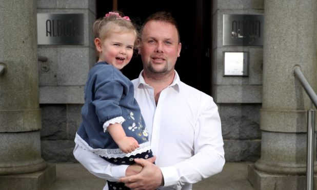 New owner of The Albyn, Simon Cruickshank, and his three-year-old daughter, Sienna, on the terrace.