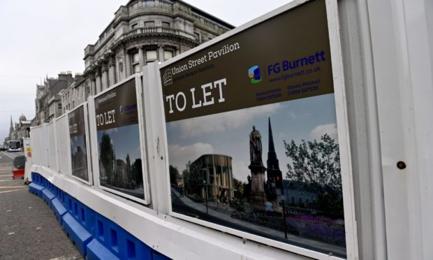 Signs erected by Aberdeen City Council and FG Burnett on the barriers surrounding Union Terrace Gardens, advertising the new pavilions up for let.