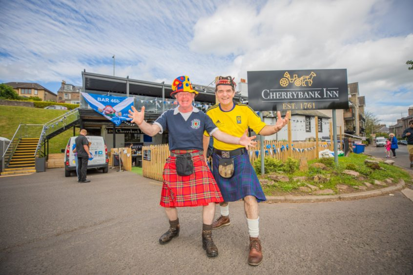 Colin O'Hara, left, and Thomas Paterson get ready to cheer Scotland on.
