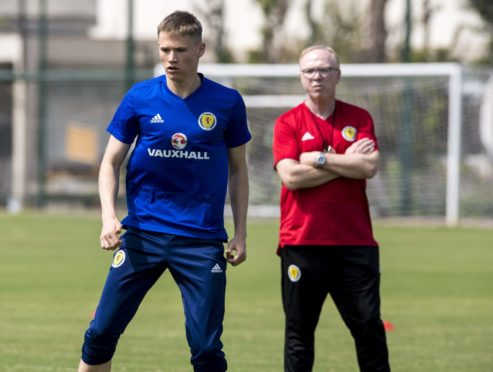 Scott McTominay in Scotland training, with Alex McLeish watching on.