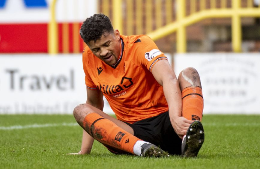 Osman Sow feels his Achilles in his final Dundee United match.