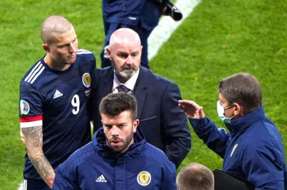 Scotland's Lyndon Dykes and manager Steve Clarke react after the final whistle.