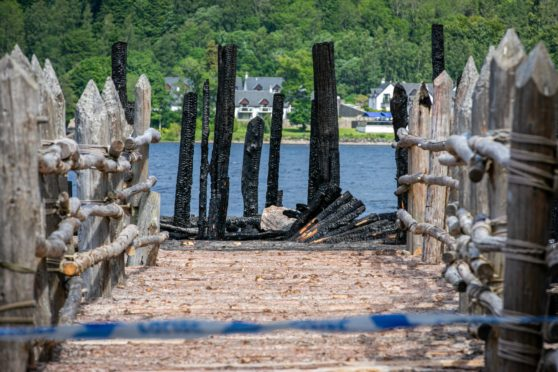 A close-up image of the charred remains of the Crannog Centre fire