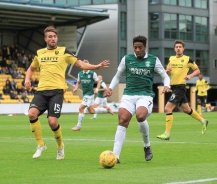 Morgyn Neill, left, in action for Livingston, with Declan Gallagher in the background.
