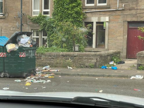 Rubbish is strewn across the street in Taylor's Lane.