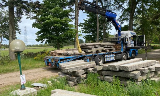 Granite from UTG was being loaded on to flatbed trucks when we arrived at Mike Wilson's home last week.