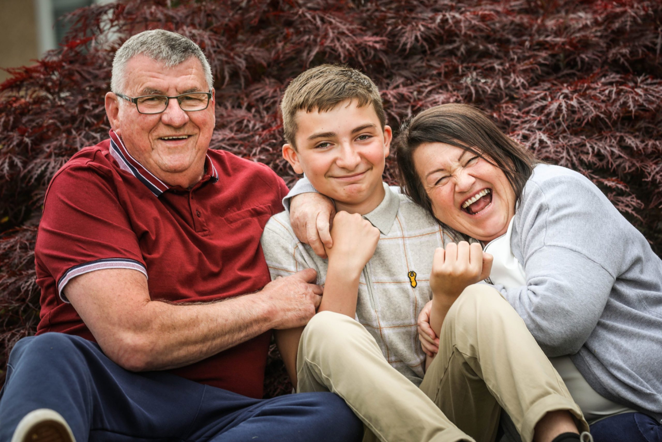 A thirteen year-old boy having fun with his foster parents