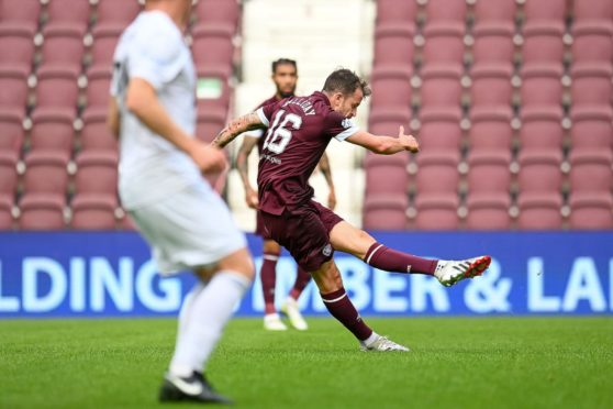 Andy Halliday gives Hearts the lead against Cove Rangers.