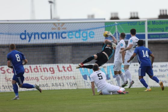Scott Brown clips in the opening goal for Peterhead.