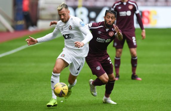 Cove Rangers' Connor Scully holds off Josh Ginnelly of Hearts.