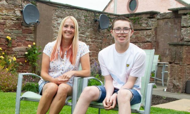 Adam, who has Glut1 deficiency, with mum Stefanie