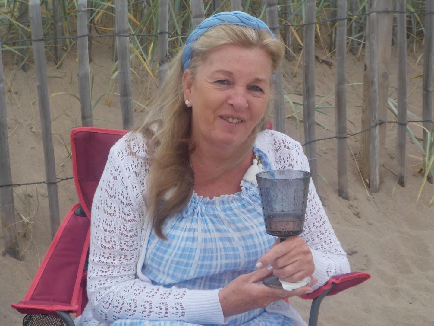 Margaret Binks with a drink in hand on Broughty Ferry beach