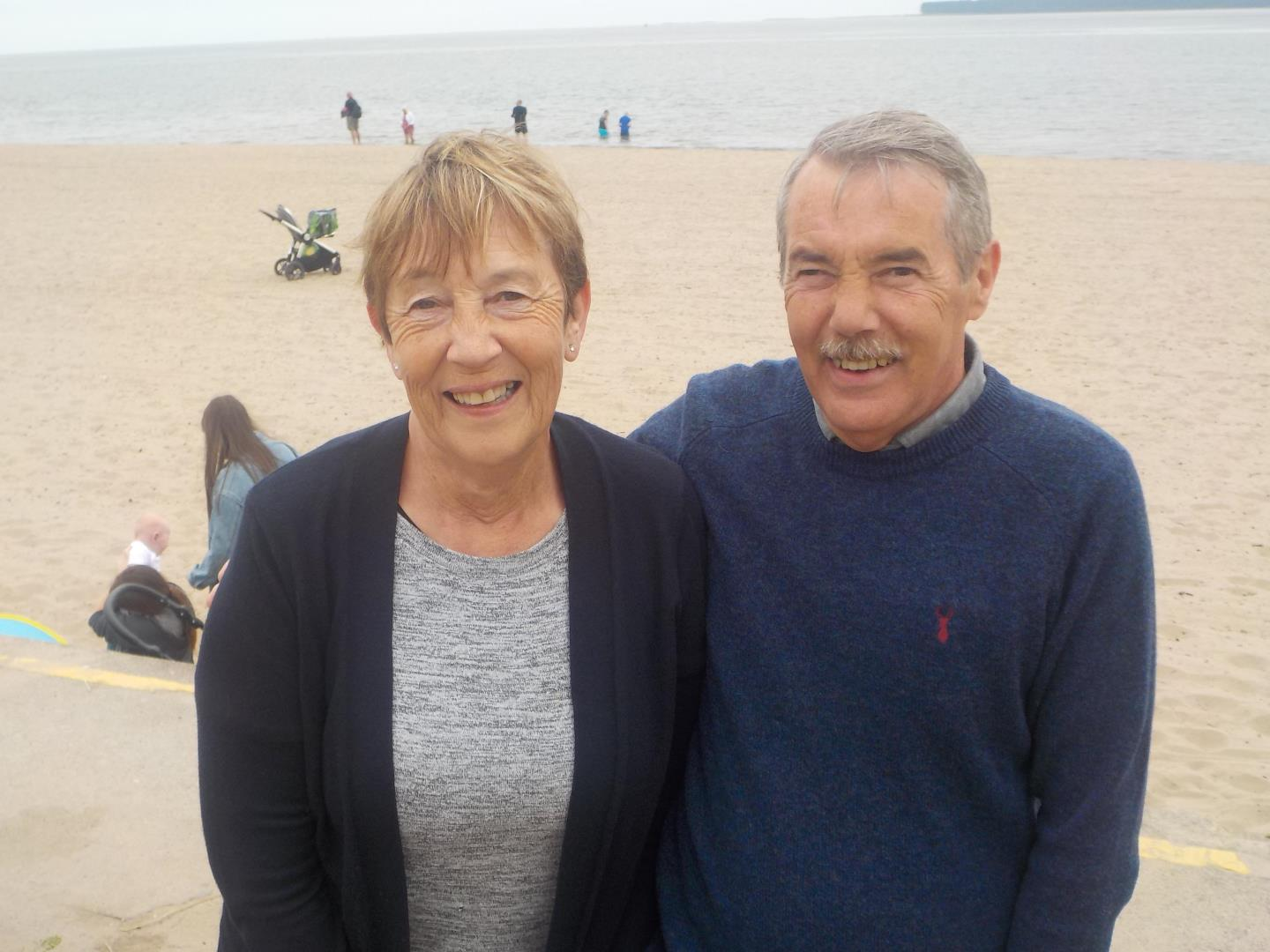 Connie and Bruce Clark standing on the beach