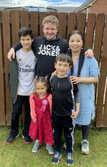 Chris and his wife Papi, whom he met at work, with their children, Daniel, Sion and Kikka.