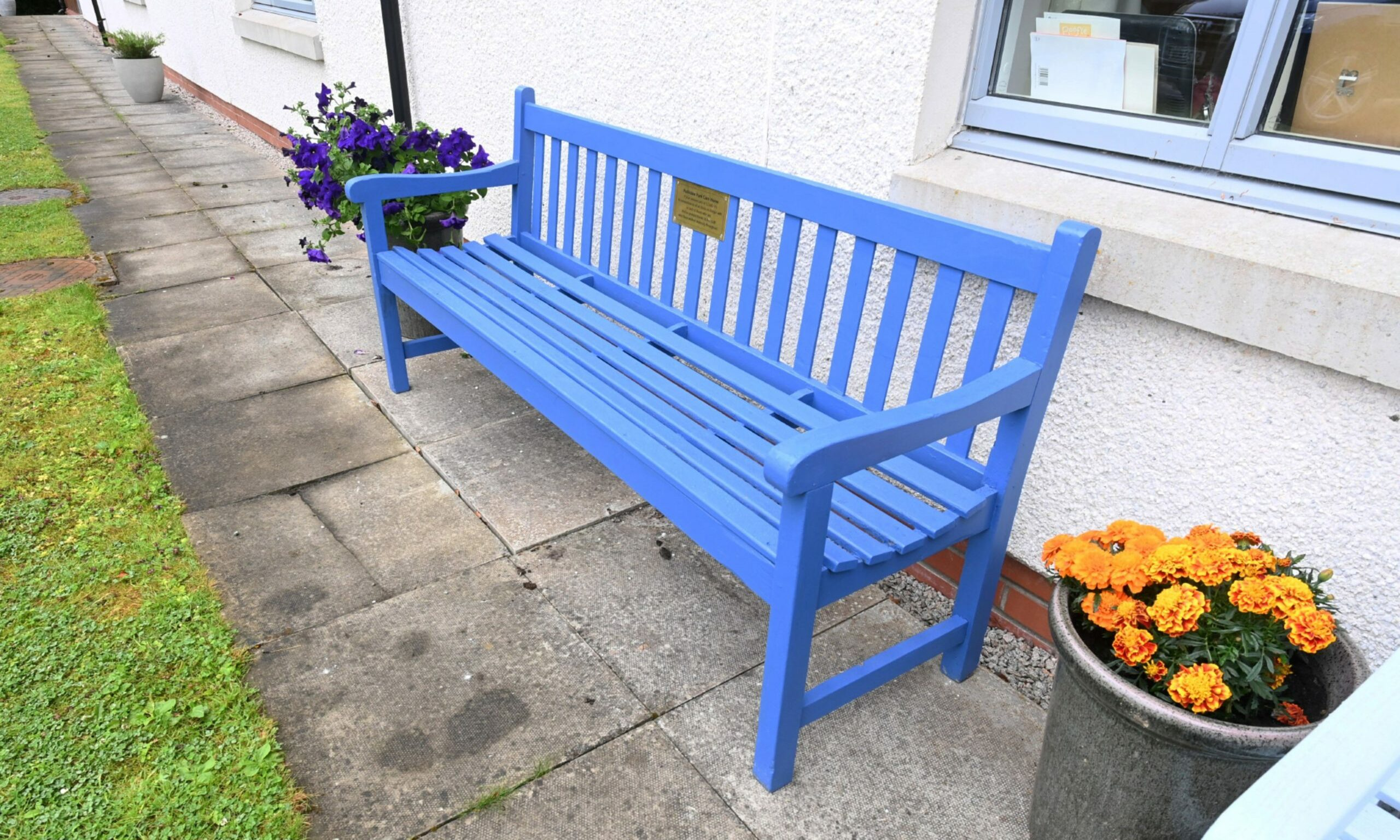 A memorial bench has been dedicated to the staff and residents affected by Covid-19. Picture by Chris Sumner.