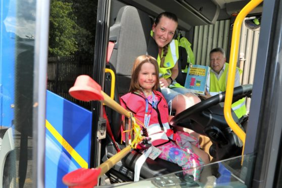 Casey Bell who was three when she started litter picking, with Laura Bell and Councillor Angus Forbes.