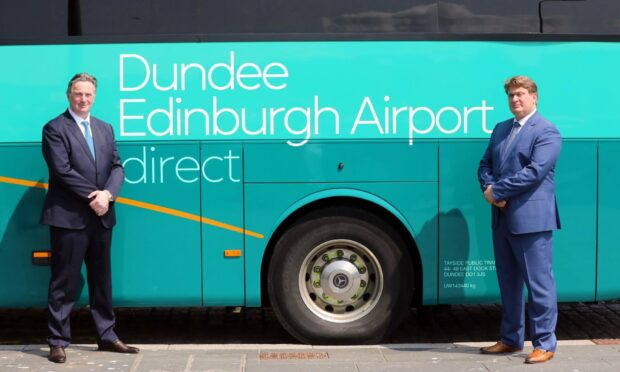 Sandy and James Easdale, of McGill's Buses, with the Dundee to Edinburgh Airport bus service.