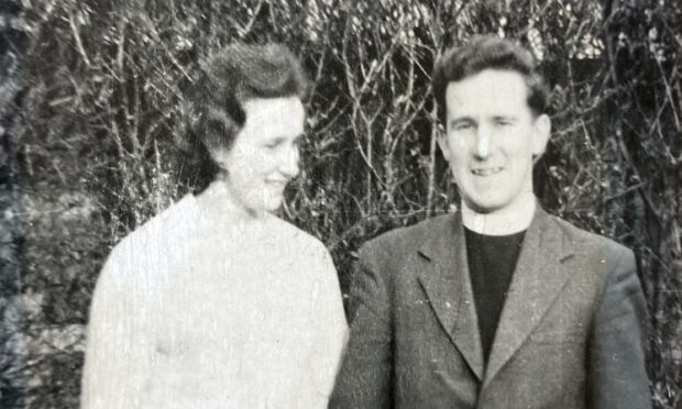 Jessica Gordon is pictured looking lovingly at her husband, the Rev Ken Gordon who is pictured in tweed jacker and dog collar.