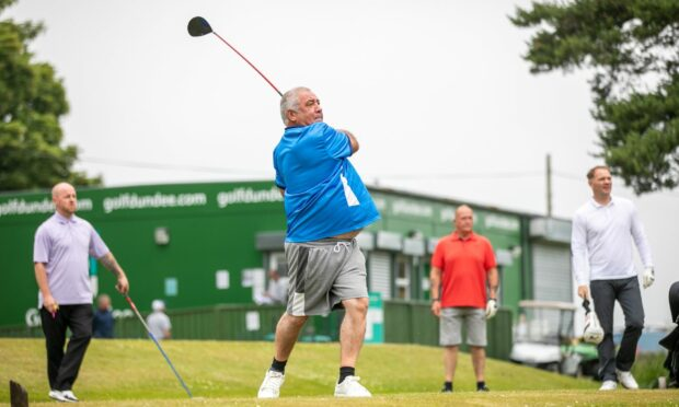 Mark Davie tees off at Caird Park Golf Club at the memorial event for Charlie Adam