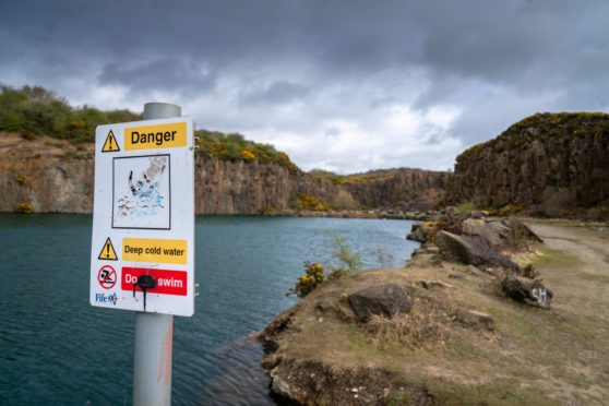 A danger sign warning of swimming in a loch