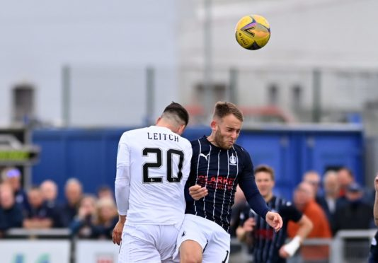Robbie Leitch challenges former Cove Rangers player Seb Ross.