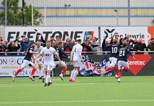 Aidan Nesbitt celebrates after putting Falkirk in front against Cove Rangers.