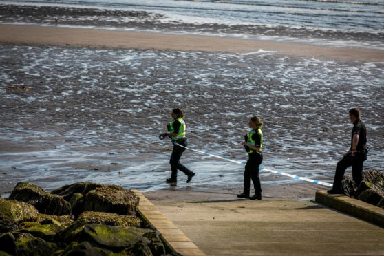 Police seal off the area after the discovery of a body at a Kirkcaldy beach.