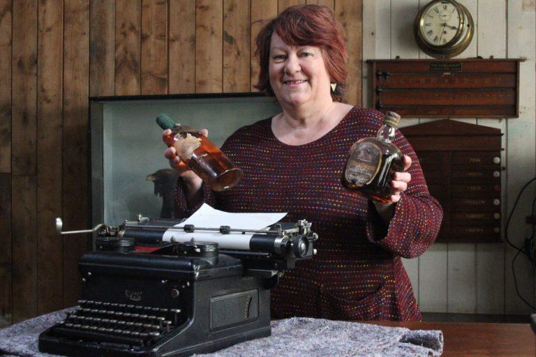 Curator Fiona Mackenzie with Sir Compton Mackenzie's typewriter at Canna House in the Hebrides.