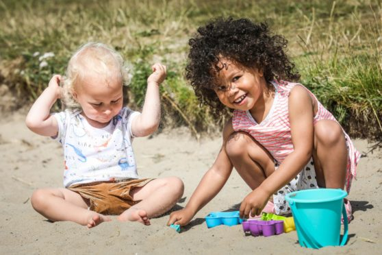 Dominik Samsik, 1 and Ines Awe, 2 play together in Broughty Ferry