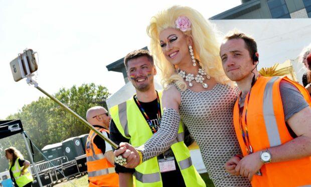 Liam Jones (far right) at Grampian Pride at the Beach Boulevard with Romy Deepcheeks.