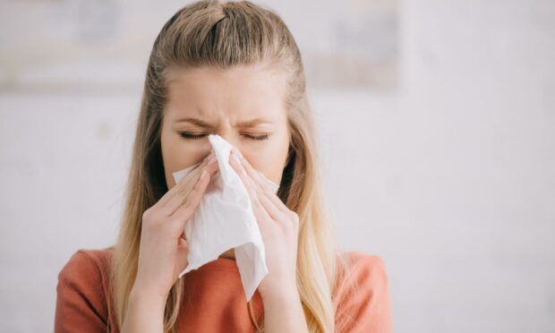 Sneezing is becoming an increasingly-common Covid symptom - but only among those who have received both doses of the vaccine.