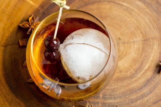 Vegan cocktail Black cherry bourbon cola.