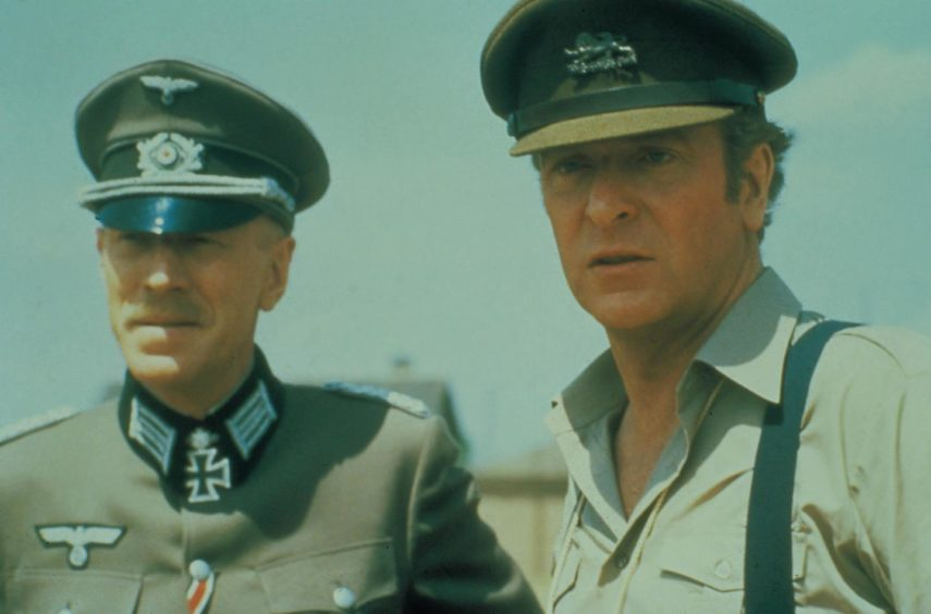 Max Von Sydow and Michael Caine agree to a friendly match between the Allies and an all-star Nazi XI.