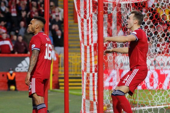 Funso Ojo and Ryan Hedges celebrate giving Aberdeen the lead.