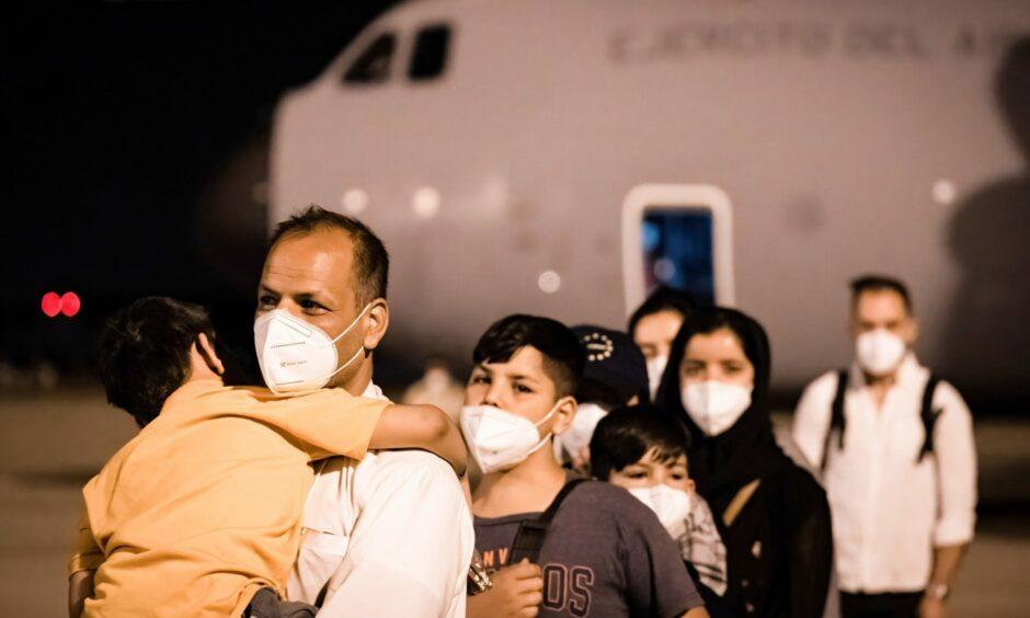 Afghan refugees arrive at the Torrejón de Ardoz military base in Madrid.