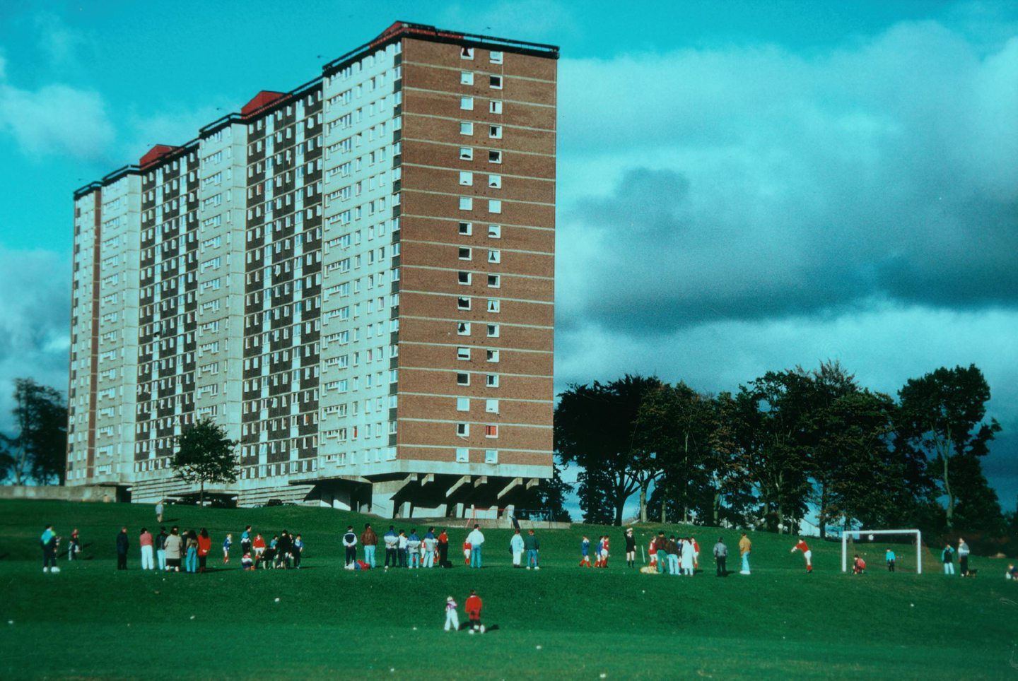 locals watch a football match at pitches next to the Ardler Multis in 1991.