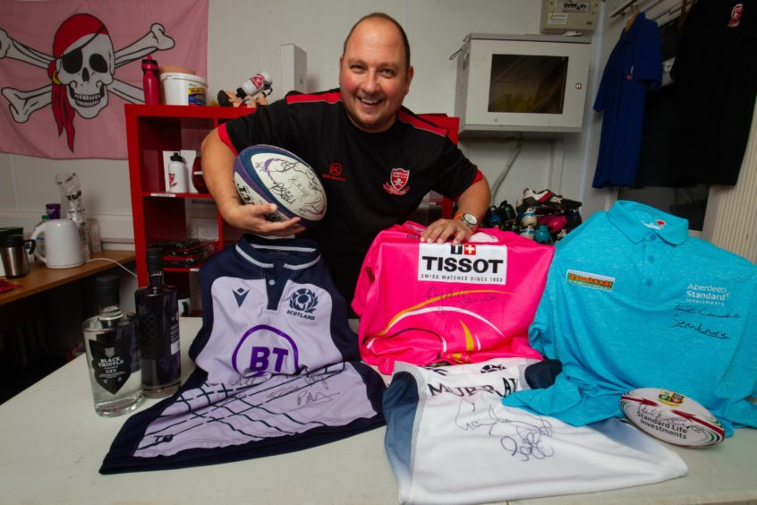 Club chairman MIke Reid with some of the auction lots.