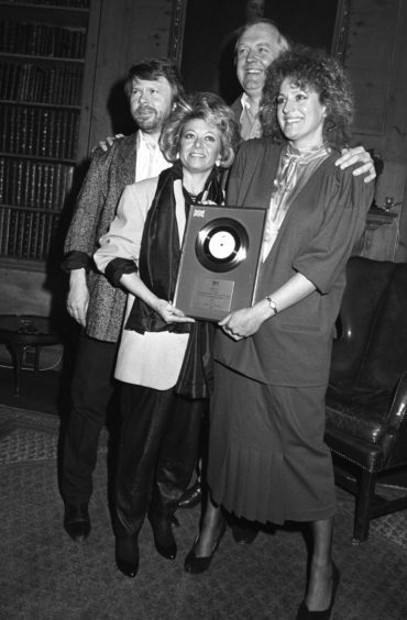 Bjorn Ulvaeus, Tim Rice and Elaine Paige and Barbara Dickson collect a silver disc for sales of the album Chess.