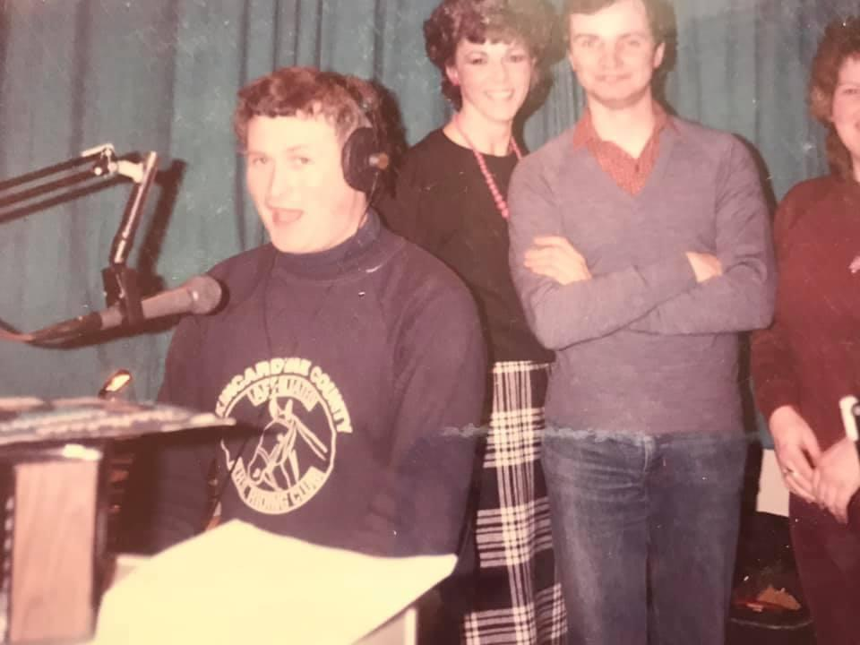 Ian Mckessock at the mic with some of his Grampian Hospital Radio colleagues.