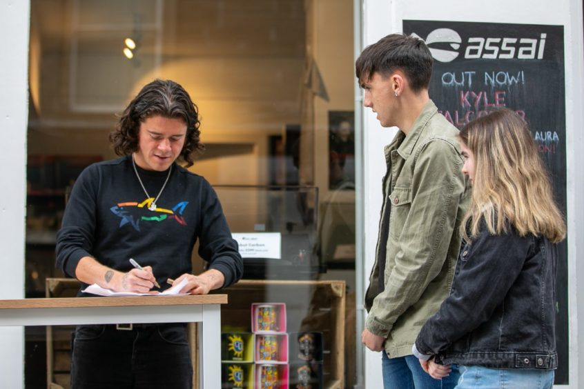 Fans lines the street as The View lead singer Kyle Falconer held a signing in city centre record shop Assai Records this month to promote his new album.
