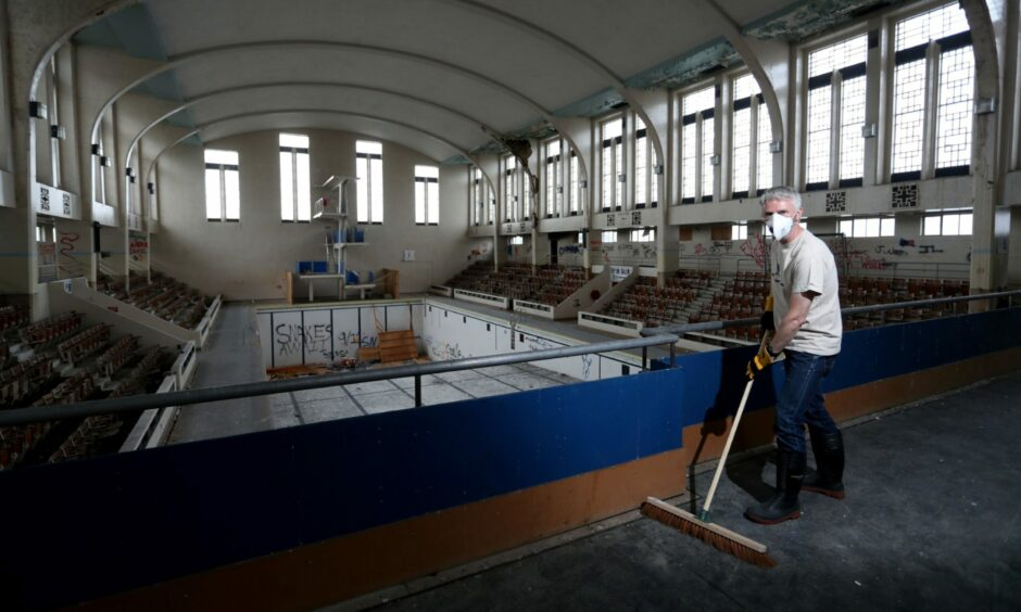 New Bon Accord Heritage chairman Bruce Strachan, pictured in August 2020, cleans up debris left by the elements and vandals at Bon Accord Baths.
