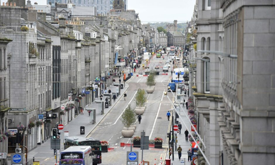 Photos taken from the balcony of Aberdeen Town House show vegetation in gutters, several storeys above Union Street.