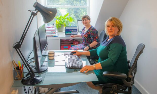 Sarah-Jane Dale and Karen Nichols of the Skills Collective in the office.