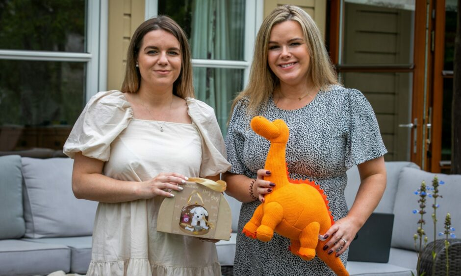 Amanda Cramb and Lisa Cramb with baby toys from online shop Annie's Accessories.